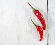 Close up fresh chili peppers on wooden background Stock Photo