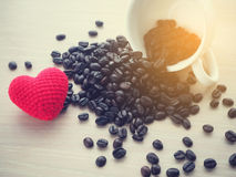 Close up of fresh coffee bean and red heart shape sign. Stock Photo