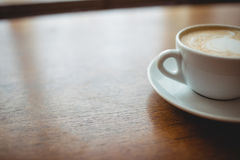 Close-up of fresh coffee served at cafeteria. Close-up of fresh frothy coffee served on table at cafeteria Royalty Free Stock Image