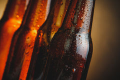 Close-up of fresh cold beer ale bottles with drops and stopper Stock Photography