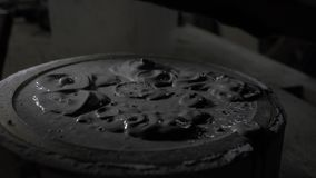 Close-up of fresh concrete is added to a special mold for casting parts. wet concrete in silicone form. 4k. 4k video. slow motion. 23.98 fps stock video footage