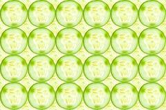Close up of fresh cucumber slices background. Close up of fresh cucumber slices Royalty Free Stock Photo