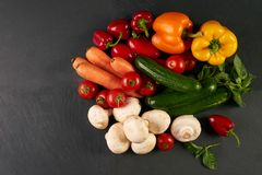 Fresh raw vegetables. Close-up of a fresh delicious ingredients for healthy cooking or salad making on rustic background, top view, banner. Diet or vegetarian Stock Photos