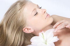 Close-up fresh face. Close-up beautiful fresh blond lady with lily royalty free stock photos