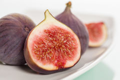 Close up of fresh figs on plate. Royalty Free Stock Photo