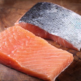 Close up Fresh Fish Meat on Wooden Board Royalty Free Stock Photos