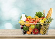 Close-up of fresh food in shopping cart on. Healthy lifestyle eating healthy organic food white background close-up shopping Royalty Free Stock Photo