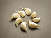 Close up of fresh garlic cloves on wooden table royalty free stock photography