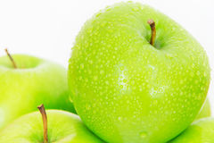 Close up fresh green apple with droplet Royalty Free Stock Images