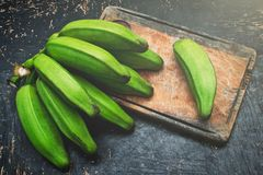 Green banana on a rustic wood table royalty free stock photo