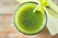 Close up of fresh green juice glass and celery Stock Photography