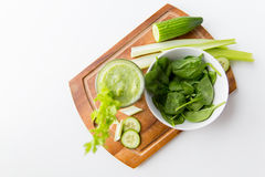 Close up of fresh green juice glass and celery Stock Image