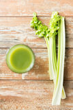 Close up of fresh green juice glass and celery Royalty Free Stock Photography