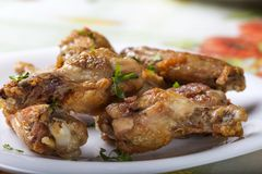 Close up of fresh Grilled chicken drumsticks with parsley leaves Stock Images