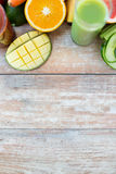 Close up of fresh juice glass and fruits on table Royalty Free Stock Images
