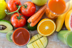 Close up of fresh juice glass and fruits on table Stock Photos