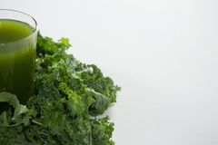 Close up of fresh juice by green kale Stock Images