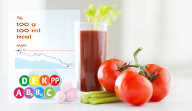 Close up of fresh juice and vegetables on table Stock Photo