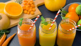 Close up of fresh juices in mason jar glasses. Healthy eating, drinks, diet and detox concept - close up of fresh fruit or vegetable juices in mason jar glasses stock video footage