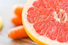 Close up of fresh juicy grapefruit slice on table Stock Photo