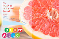 Close up of fresh juicy grapefruit slice on table Stock Images