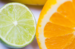 Close up of fresh juicy orange and lime Royalty Free Stock Photography