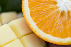 Close up of fresh juicy orange and mango slices Stock Images