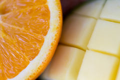 Close up of fresh juicy orange and mango slices Royalty Free Stock Photography