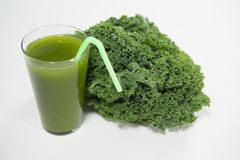 Close up of fresh kale and juice. On white background Stock Image