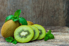 Close up fresh kiwi fruit on old wood background. Stock Photography