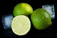 Close-up of fresh lime with ice cubes Royalty Free Stock Photos