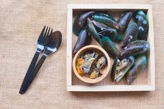 Fresh mussel shellfish on wood box tray. Close up of Fresh mussel shellfish on wood box tray Royalty Free Stock Photos