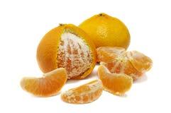 Close up of fresh orange mandarine and wedges. Isolated over white Stock Photos