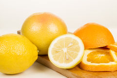 Close up of fresh oranges on wooden board. Lemon Royalty Free Stock Images