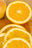 Close up of fresh oranges on wooden board. Studio shot Royalty Free Stock Photo