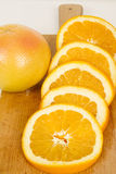 Close up of fresh oranges on wooden board. Studio shot Royalty Free Stock Images