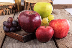 Close up of fresh organic fruits , apples and grapes on the wood Stock Image