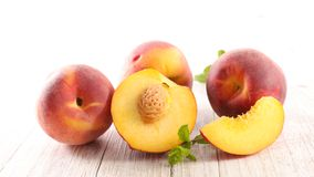 Fresh peach and leaf. Close up on fresh peach and leaf royalty free stock image