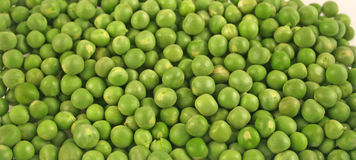 Close up of fresh peas. Close up of fresh green peas suitable for background Royalty Free Stock Images