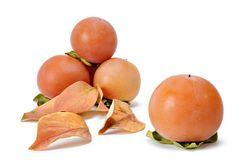 Fresh persimmons on white background Royalty Free Stock Photography