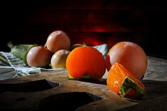 Fresh persimmons freshly picked on an old wooden table Stock Photography