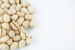Close up of fresh pistachios. On white Royalty Free Stock Photo