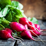 Close up Fresh Radish on wooden background Royalty Free Stock Photos