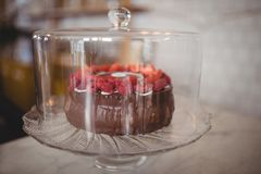 Close up of fresh raspberry cake in glass container on table. At coffee shop Royalty Free Stock Images