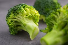 Close up of fresh raw green broccoli. On a table. Diet healthy product Royalty Free Stock Photo