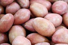 Close-up of a fresh raw potatoes background. Close-up of a fresh raw potatoes background Royalty Free Stock Photo