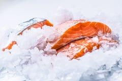 Close-up Fresh raw salmon fillets on Ice Stock Photo
