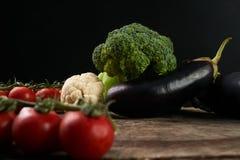Close-up of Fresh raw vegetable ingredients. For healthy cooking or salad. Dark background, copy space. Diet , vegetarian or vegan food Royalty Free Stock Image