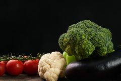 Close-up of Fresh raw vegetable ingredients for healthy cooking or salad. Dark background, copy space. Diet , vegetarian or vegan food Royalty Free Stock Photo