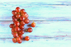 Close up fresh red grape on wooden table. Top view with copy space Stock Image